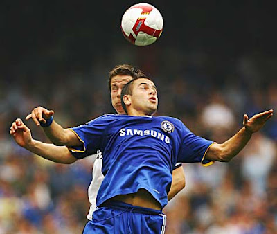 Chris Gunter of Tottenham Hotspur challenges Joe Cole (front) of Chelsea.