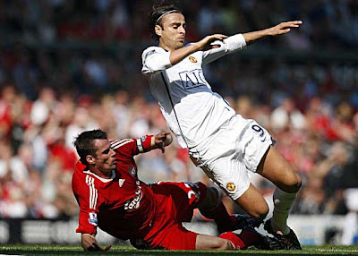Manchester United forward Dimitar Berbatov (right) is tackled by Liverpool defender Jamie Carragher.