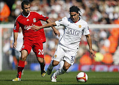 Liverpool midfielder Javier Mascherano (left) closes in on Manchester United forward Carlos Tevez during their English Premier League football match at Anfield in Liverpool, north west England on September 13, 2008.