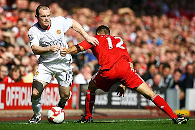 Fabio Aurelio of Liverpool is beaten by Wayne Rooney of Manchester United.