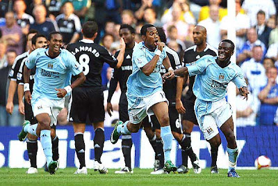 Robinho of Manchester City is mobbed celebrates after he scores the first goal of the game off a free kick to start his England career.