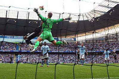 Florent Malouda of Chelsea heads on goal as Joe Hart of Manchester City attempts the save.
