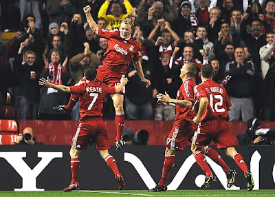 Dirk Kuyt of Liverpool celebrates scoring the opening goal with his teammates.