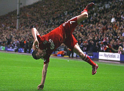 Irish striker Robbie Keane celebrates in his own unique style after scoring his first-ever goal for Liverpool and giving the Reds a 2-0 lead in the first half.