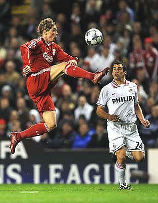 Fernando Torres of Liverpool leaps to win the ball.