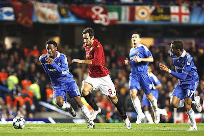 AS Roma's Captain Francesco Totti (L) and Chelsea's Captain John Terry (R) exchange pleasantries while Greek referee Kyros Vassaras (C) looks on. Unfortunately for Roma, there was nothing pleasant about their 1-0 loss to Chelsea at Stamford Bridge