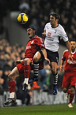 Albert Riera (left) of Liverpool and David Bentley of Tottenham compete for a header during their Barclays Premier League match at White Hart Lane in London, England.