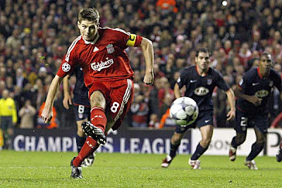 Liverpool midfielder Steven Gerrard scores against Atletico from the penalty spot. The injury-time penalty saw the Reds salvage a 1-1 draw.