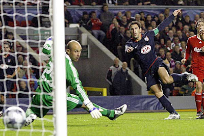 Atletico Madrid midfielder Maxi Rodriguez scores past Liverpool goalkeeper Jose Reina.