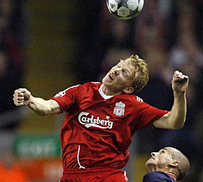 Liverpool forward Dirk Kuyt wins a header from Atletico Madrid defender Mariano Pernia during their Champions League Group D match at Anfield, Liverpool, north-west England, on November 4, 2008