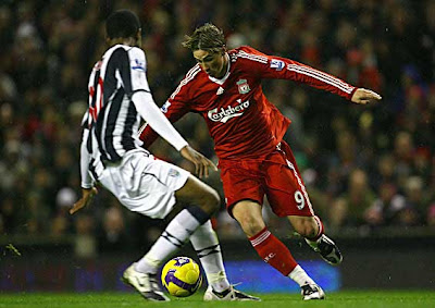 Fernando Torres of Liverpool looks for a way past Ryan Donk of West Bromwich Albion.
