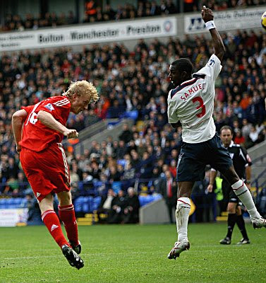 Dirk Kuyt of Liverpool scores the first goal of the game