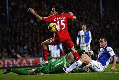 Yossi Benayoun of Liverpool gets through clear on goal but misses past keeper Paul Robinson and Andre Ooijer of Blackburn Rovers. Liverpool, though, won the game 3-1.
