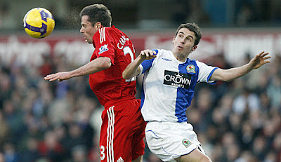Liverpool's defender Jamie Carragher (left) is challenged by Blackburn Rovers' defender Keith Andrews during their English Premier League football match at Ewood Park, Blackburn, north west England.