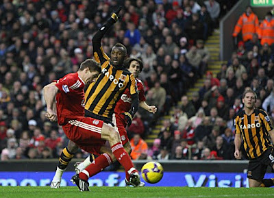Steven Gerrard of Liverpool scores his team's second and equalizing goal against Hull City