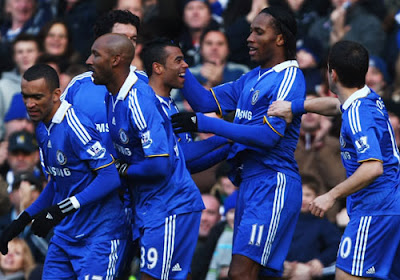 Didier Drogba of Chelsea celebrates with team mates as he scores their first goal