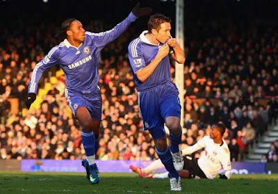 Frank Lampard of Chelsea and teammate Didier Drogba celebrate after scoring the goal to equalise