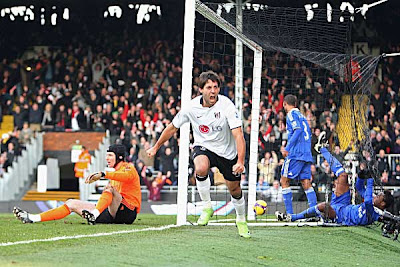 Clint Dempsey of Fulham celebrates after scoring the opening goal against Chelsea at Craven Cottage in London, England.