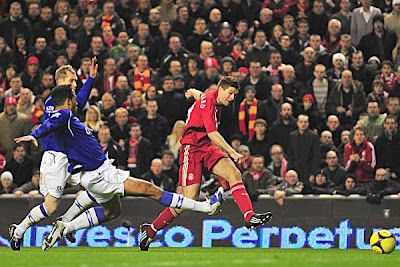 Steven Gerrard of Liverpool scores against Everton in the second half. Gerrard's strike earned the Reds a 1-1 draw, and a short trip to Goodison Park for a Fourth Round Replay.