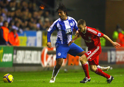 Mido of Wigan Athletic battles with Fabio Aurelio of Liverpool