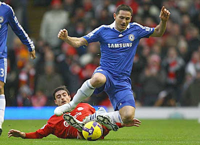 Albert Riera of Liverpool brings down Frank Lampard of Chelsea during their Premier League match at Anfield on February 1, 2009 in Liverpool, England.