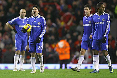 Chelsea midfielder Deco and teammates show their dejection at the end of the match against Liverpool. Fernando Torres scored again as the Reds won 2-0.