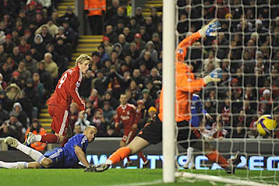 Fernando Torres of Liverpool scores past Chelsea goalkeeper Petr Cech in the 89th minute.
