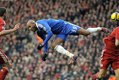 Chelsea forward Nicolas Anelka heads the ball during the match against Liverpool.
