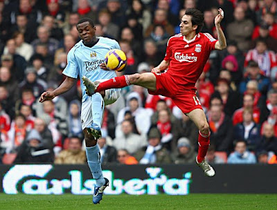 Yossi Benayoun of Liverpool competes for the ball with Nedum Onuoha of Manchester City during their Barclays Premier League match at Anfield on February 22, 2009 in Liverpool, England.