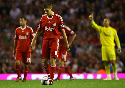 Steven Gerrard of Liverpool looks dejected after his team conceded a second goal