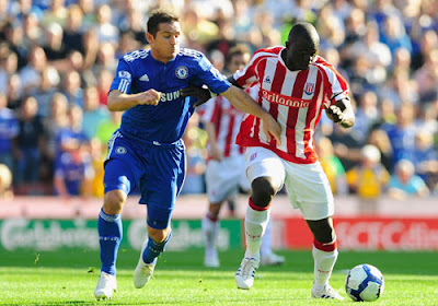 Abdoulaye Faye of Stoke City battles for the ball with Frank Lampard of Chelsea