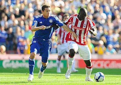 Abdoulaye Faye of Stoke City battles for the ball with Frank Lampard of Chelsea.