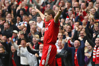 Steven Gerrard of Liverpool celebrates scoring his team's fourth goal in their 6-1 victory over Hull City.