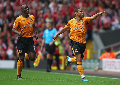 Geovanni (right) of Hull City celebrates scoring his team's first goal with teammate George Boateng during their match against Liverpool at Anfield.