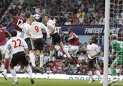 West Ham striker Carlton Cole (center) scores West Ham's second goal against Liverpool.