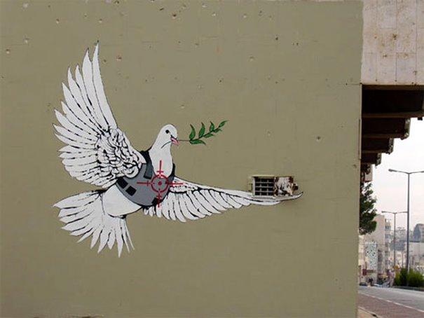 Paloma de la paz en la mira del sistema militarista del capitalismo
