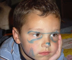 Greyson paints his own face!