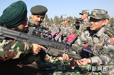 Indian soldier examines a Chinese weapon