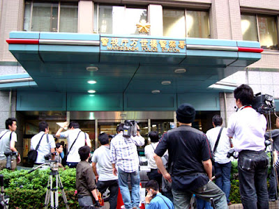 Media scrum outside Manseibashi Police Station