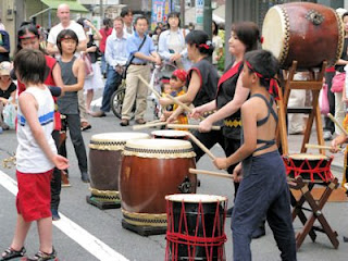 Children's drumming troupe at Yoyogi-hachiman street festival, Tokyo.