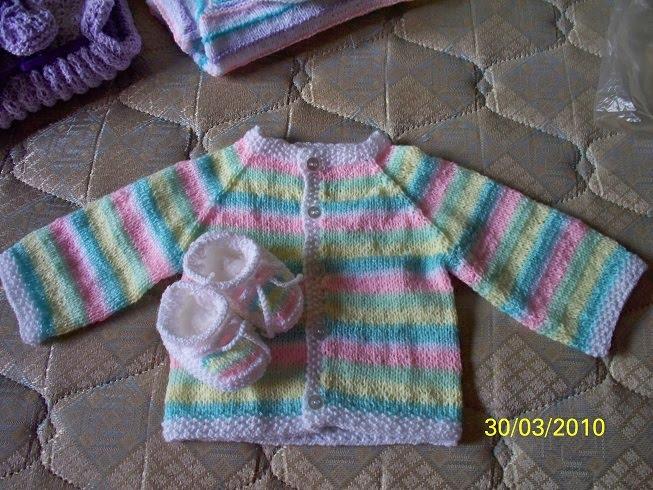 Saquitos para bebé tejidos a dos agujas - Imagui