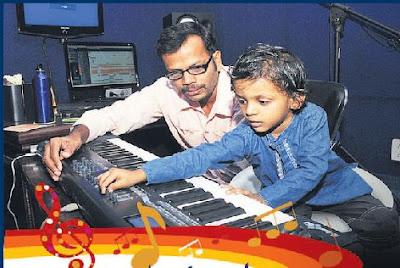 Na Muthukumar's Son Aadhavan with musician Kumaran