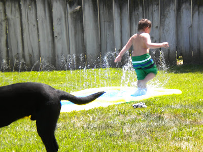 Brian running down the slip-n-slide with Dagan's butt in the foreground