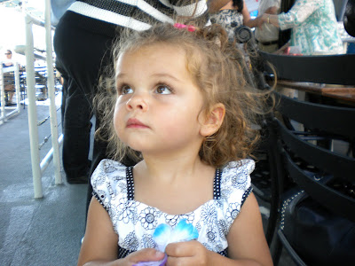 18 month old Caitlyn, curly hair and cute face in her pretty party dress