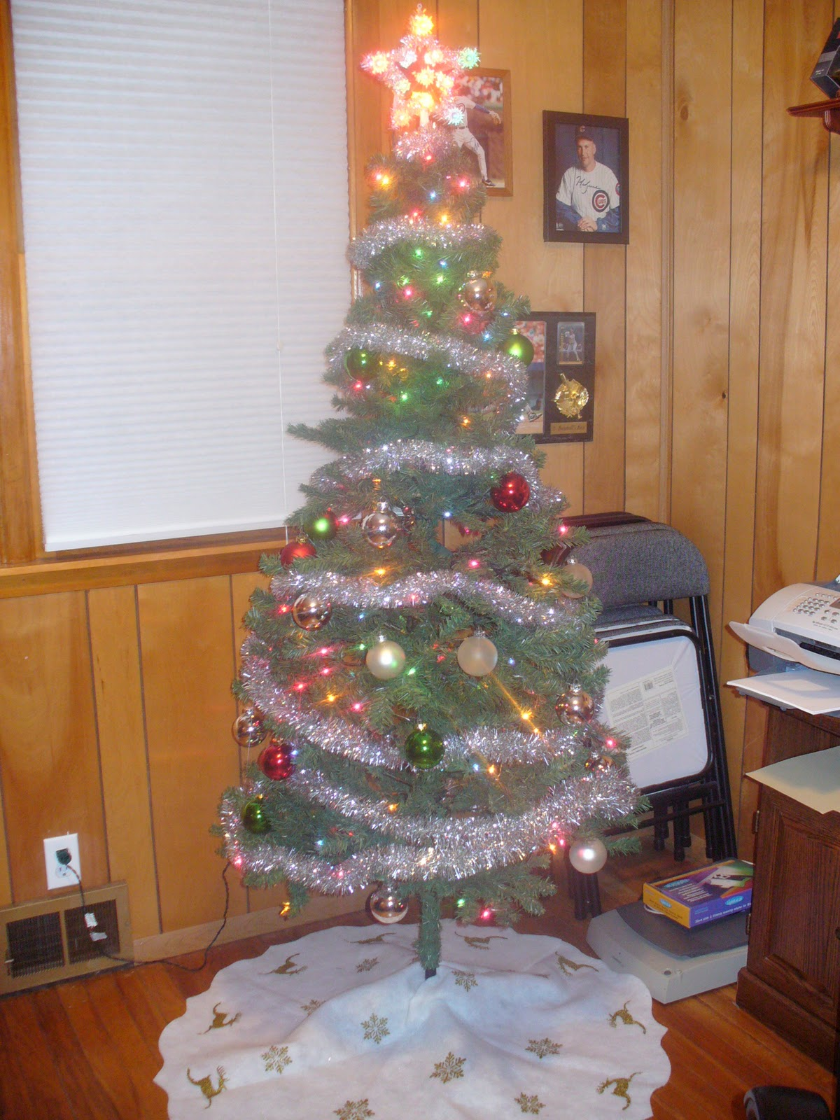 notice the sports theme evident on the wall this is his normal tree colored lights silver star with colored lights solid colored ball ornaments