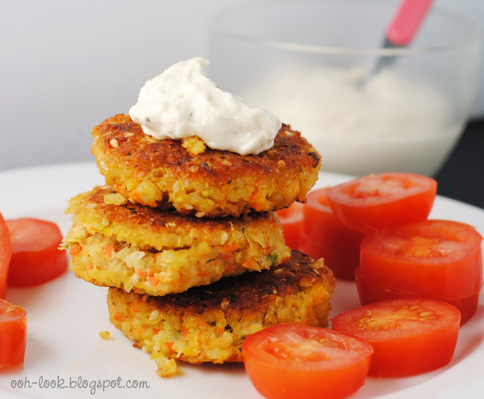 Serve the quinoa and chickpea fritters with tzatziki and tahini sauce.
