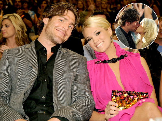 Mike Fisher And Carrie Underwood Kissing. Carrie Underwood receives a