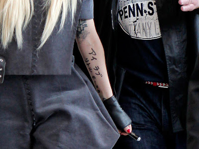 Lady Gaga Japanese Tattoo. Singer Lady Gaga gestures on