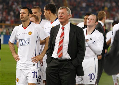 alex ferguson looks on disconsolate as barcelona collect the champions league trophy