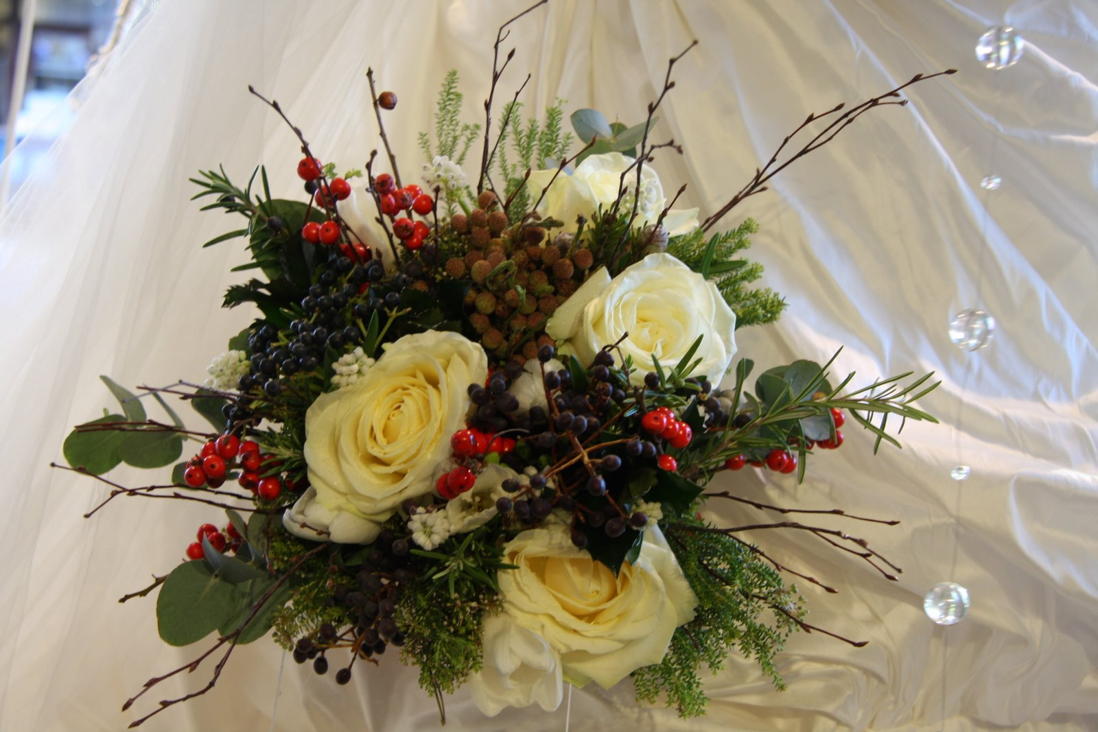 The flower magician rustic christmas wedding bouquet